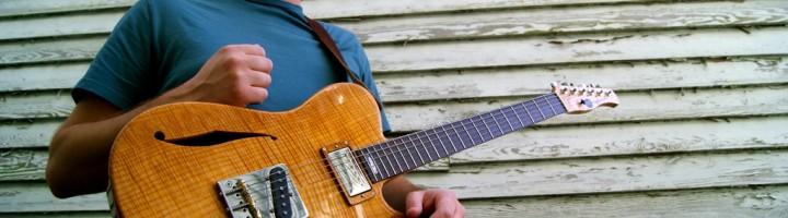 Tyler Ross with his Koentopp Guitars